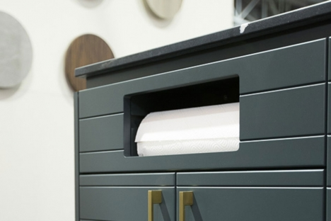 Integrated paper towel dispenser